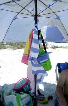 Keep your stuff out of the sand and  help your towels dry with this handy beach umbrella hook.
