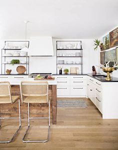 Love the wood on the island and the metal open shelving