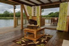 Cast off from the real world at a floating cabin for 4 on a sun-dappled lake - with a private hot tub!