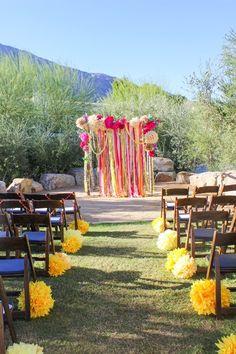 Love the paper pop aisle decor! DONE!    Wedding Photos on WedOverHeels