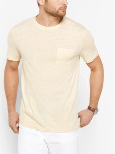 Crafted from linen and cotton, this lightweight T-shirt features a subtle dot pattern and a patch pocket. Complement its casual style with denim or shorts and a pair of sneakers.