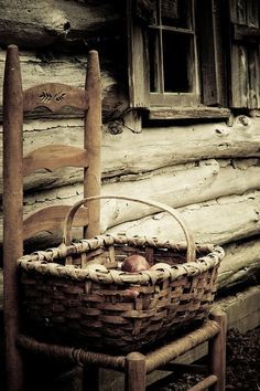 old woven basket.old farmhose and chair.all rustic.