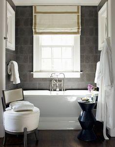 I am a huge fan of black slate tiles in the bathroom & kitchen back splash. Used them in a vintage hotel renovation and loved it!