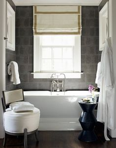 Contrast of white and blue grey tones. I love the touch of brass tones hinted in the roman shade - picking up on the brass tones in accessories would make this bathroom fabulous.