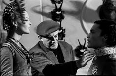 Director Luchino Visconti, Romy Schneider and Helmut Berger on the set of Ludwig, 1972.