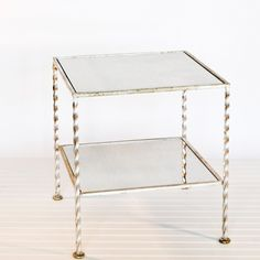 2 tier square table in silver leaf with antique mirror. 725.00