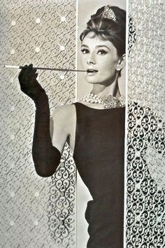 Hepburn...Breakfast at Tiffany's SHE SET THE STANDARD......elegant tiara, and long ciggarette holder, multiple strands of pearls and elegant long black gloves.....pretty sure she invented, LBD....or at least mainstreamed it. -C