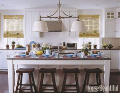 Double pendant fixture above a large kitchen island. Design: Meg Braff.