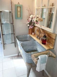 Ultimate rustic bathroom with ladder towel rack reclaimed window mirrow and washbin sinks.