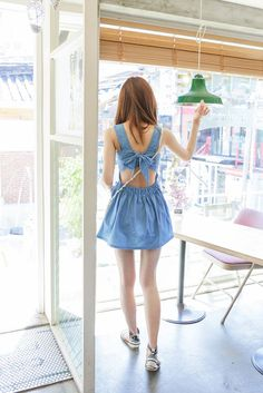 chambray blue back cut-out dress with bow, white shoulder bag, striped sandals