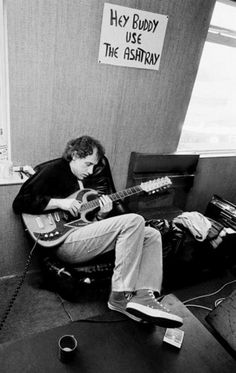 Mark Knopfler of Dire Straits, playing a Baldwin Burns Double Six 12-string guitar