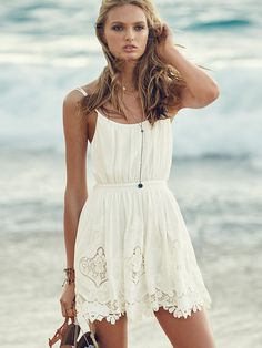 It's official: this little white dress is a staple for all the beach vacays and music festivals on your calendar. Light as air and beyond beautiful, it's got that effortlessly chic look down to a science. | Victoria's Secret Tie-back Embroidered Cover-up Dress