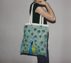Creative peacock tote bag with long handles/ hand painted bag/ handbag/ shopping bag/ market bag/ selfmade design/ bird/ feathers Painted Bags, Hand Painted, Peacock Design, Market Bag, Handmade Design, Whales, Bird Feathers, Yellow, Blue