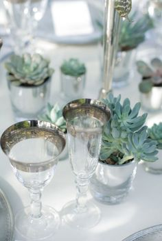 Elegant wedding table design colored green plants