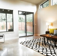 These 29 incredible concrete floor ideas will inspire and delight. Check out more design ideas on Domino. Living Room Flooring, Living Room Decor, Living Rooms, Concrete Floors In House, Cement Floors, Flooring Options, Flooring Ideas, Stained Concrete, House Design