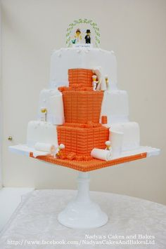This is my first proper wedding cake. The bride and groom came up with the idea I just executed it. I am sure there are other lego cakes out there but I am super proud of this one, took me ages to plan and make (and a few sleepless nights!). Before you ask, all lego people are actual lego.