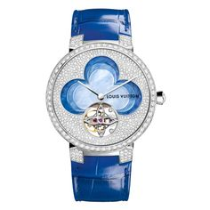 - The Louis Vuitton Blossom Tambour Monogram tourbillon watch features a carved mother-of-pearl flower on the dial. Made at Vuitton's Fabrique du Temps facility in Geneva, the dial of the Tambour watch is set with diamonds as well as a mother-of-pearl centrepiece. On this version, one of the petals is replaced by the flower-shaped cage of the tourbillon. Available in the vibrant colours of spring blue and pink.