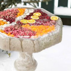 Once the birds have flown south, take advantage of your empty birdbath for this dazzling holiday decoration! http://www.bhg.com/christmas/outdoor-decorations/outdoor-holiday-decorating-ideas/?socsrc=bhgpin120614fruitfilledbirdbath&page=16