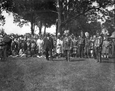 Members of the Chickahominy, Pamunkey, and Mattaponi tribes pose for an unknown photographer at an intertribal powwow at the Chickahominy reservation in New Kent County late in the 1920s. Among those present are Jane Miles and Reverend L. H. Suddith. In foreground, from left to right are Pamunkey chief George Major Cook, Chickahominy chief O. W. Adkins, Peter Adkins, and Tazewell Adkins.