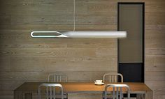 We are loving this new Infinito Light by QisDesign, an award winning, one-of-a-kind LED suspension lamp that functions both as illuminating and atmospheric lighting. Inspired by the symbol of infinity, the sleek ceiling lamp features a large loop tha Neon Lighting, Lighting Design, Dining Room Lighting, Led Ceiling, Led Lamp, White Light, Modern Furniture, Modern Design, Lights