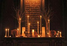 Love the candles with their varying heights and sizes.  This is so reverent. I could see this as a memory table with photos of your deceased loved ones in the background at your wedding.