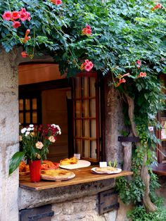 Selling cakes out of the window | Pérouges, Rhone-Alpes, France