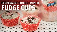 Peppermint Cookie Crunch Fudge Cups-This fudge is so easy that even children can make it. This sweet treat makes a perfect gift when wrapped in a clear bag with a pretty ribbon. Learn how to make this no-bake dessert recipe with our step-by-step video. Perfect for parties, the holidays or anytime you want to celebrate with a yummy treat.