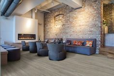 Modern Vinyl Plank Flooring For Great Flooring Solution Ideas : Modern Living Room With Ceiling Lighting And Brick Wall Also Fireplace With Gray Sofa And Swivel Chairs Plus Vinyl Plank Flooring With Upholstered Stools