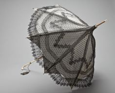 Woman's Parasol - Europe, circa 1865. Silk lace, silk plain weave (taffeta), wood, and ivory.