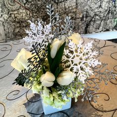 """Holiday party cocktail table centerpiece """"snowflakes""""!  #paulfennerfloraldesign #centerpieces #christmasflowers #holidaythemeflowers"""