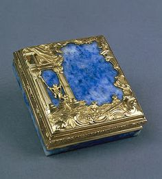 Beauty-Spot Box.  Gold, lapis lazuli, rock crystal and glass; chased, engraved and polished. 2x6x5.2 cm  Russia. St Petersburg. Mid-18th century  Source of Entry:   Imperial Gallery of Objects of Great Value. Before 1859