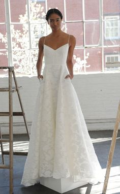 Spaghetti strap A-line wedding dress with pockets from Lela Rose Spring 2017