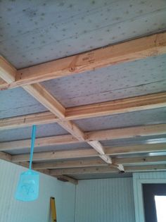 1968 mobile home transformation - installing shiplap to the ceiling of a home - before