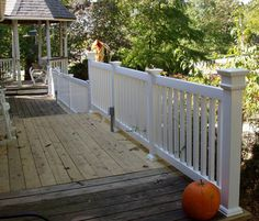 Vinyl porch railing with wood deck. No paid to g or maitainenc
