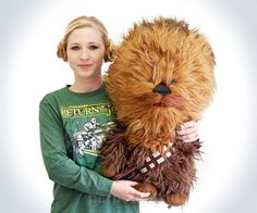 """Life-sized is still a few feet away, but this giant Chewbacca plush toy measures in at a formidable 24"""" tall x 15"""" wide. Which is probably bigger than the kid you're going to pretend you're buying him for. And when you press on his stomach, he growls. With Chewbacca by your side, your days of flying solo are about to turn into days of flying Han Solo. Yo, Chewie! Fire up the Millennium Falcon!  $87.99"""