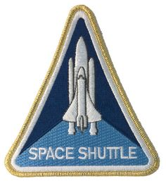 This fully embroidered patch is only one of two triangular shaped designs of the entire official NASA collection (the other being Apollo 8 ). It features the Space Shuttle in its pre-launch configurat Cosmos, Nasa Store, Nasa Space Center, Space Patch, Nasa Patch, Nasa Missions, Nasa Astronauts, Nasa Planets, Space Program