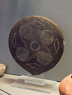 "Minoan frying pan with decorative spirals. From around 2700 to 1450 BC, the Minoan civilization flourished as a seafaring and mercantile culture. This vibrant culture was centred around the island of Crete and eventually dominated the Agean region. The Egyptians called the Minoans ""the Sea Peoples"" and had a fond appreciation for Minoan pottery and ceramics, prized for their innovative shapes and sea-inspired designs"