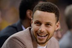Golden State Warriors' Stephen Curry (30) sits on the bench and smiles as the Golden State Warriors play against the Houston Rockets during the first quarter of Game 5 of the first round of the NBA Western Conference playoffs at Oracle Arena in Oakland, Calif., on Wednesday, April 27, 2016. (Jose Carlos Fajardo/Bay Area News Group)