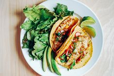 Savory pacific cod fish tacos topped with a sweet and spicy heirloom tomato and peach salsa.
