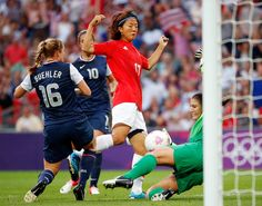 Goalkeeper Hope Solo #1 of United States makes a save on a shot by Yuki Ogimi #17 of Japan in the first half during the Women's Football gold medal match on Day 13 of the London 2012 Olympic Games at Wembley Stadium on August 9, 2012 in London, England.  (August 8, 2012 - Source: Jamie Squire/Getty Images Europe)