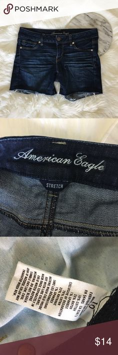 American Eagle Dark Wash Stretch Denim Cutoffs American Eagle Dark Wash Stretch Denim Cutoffs. Size 10 with stretch. Short have Distressed raw hem. Thank you for looking at my listing. Please feel free to comment with any questions (no trades/modeling).  •Fabric: Cotton Blend  •Condition: very good! No visible flaws.   ✨Bundle and save!✨10% off 2 items, 20% off 3 items & 30% off 5+ items! KB American Eagle Outfitters Shorts Jean Shorts
