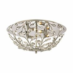 Polished Chrome Metal Clear Crystal Branch Four Light Flush Ceiling Fixture  Naturally-inspired branches of clear crystals create glistening gems of light in the Crystique collection. A Polished Chrome finish bounces light off of the canopy and fixture to further enhance its brilliant character.
