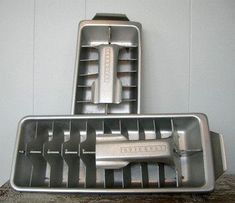 metal ice cube trays with levers to loosen the cubes (after you ran the tray under water first)