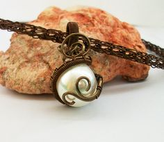 Viking knit and Ivory pearl  https://www.etsy.com/listing/235417425/pearl-tear?ref=shop_home_active_2