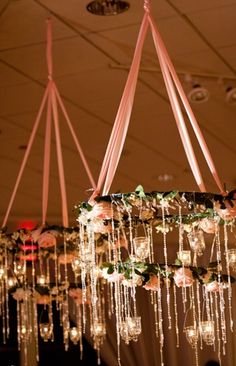 chandelier of ribbons, flowers, jars and candles