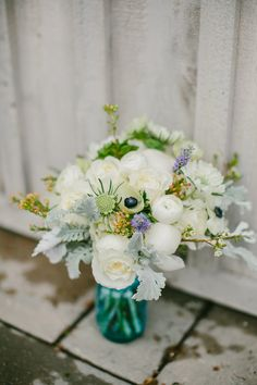 ranunculus and anemone bouquet, photo by Emily Delamater http://ruffledblog.com/marianmade-farm-wedding #weddingbouquet #flowers