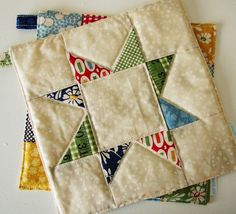 potholders - want to learn to quilt - maybe this would be the right kind of project to start with.  :)