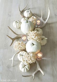 For the minimal host, an all-white centerpiece makes a stylish statement. Plus, you never have to worry about clashing.   - TownandCountryMag.com