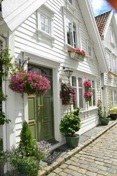 when you have no front yard you might think that you cant have any curb appeal. incorrect. to maximise your space flower boxes are a great idea.