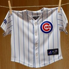 Chicago Cubs Infant Baseball Jersey - Licensed MLB Baby Clothes that is a newborn baseball home baby white pinstripe jersey with quality team graphic embroidery. Manufactured by Adidas.